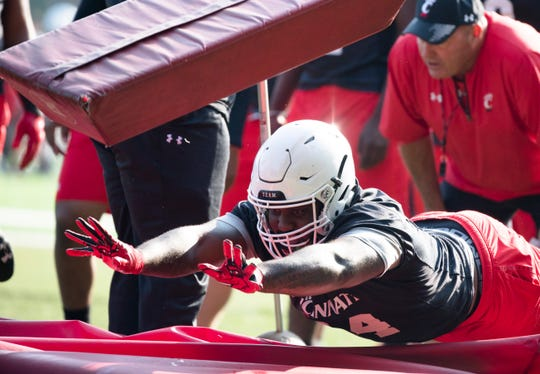 Cincinnati Bearcats defensive lineman Marquise Copeland (44) dives through a pad during University of Cincinnati Football practice at Higher Ground Convention Center in West Harrison, Ind., Friday, Aug. 3, 2018.