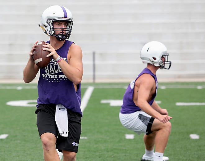 Elder quarterback Michael Bittner practices with the team Tuesday, July 31, 2018.