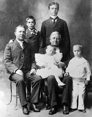 This family picture, taken about 1897, bridges four generations. Seated at left is Frederick M. Hubbell, one of the wealthiest people in Iowa history, who died in 1930 at age 91. Standing behind him are his two sons, Grover, with his hand on his father's shoulder, and Frederick C. Hubbell. Isaac Cooper, Frederick M. Hubbell's father-in-law, a nephew of novelist James Fenimore Cooper and an early Des Moines settler, is seated at center, holding James W. Hubbell, a son of Frederick C. and a grandson of Frederick M. Hubbell. James and his brother, Frederick W. Hubbell, standing at right, became trustees of the Hubbell estate, which in the 1950s owned about 80 percent of the stock of the Equitable Life Insurance Co. of Iowa.