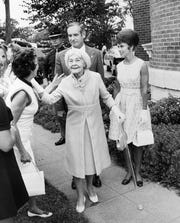 In this Aug. 24, 1971, photo, Mrs. Grover C. Hubbell, 87, whose late husband was the last descendant of Frederick M. Hubbell to live in Terrace Hill, arrives with Gov. and Mrs. Robert D. Ray for ceremonies presenting the mansion to the state of Iowa. Friends and relatives pressed forward to greet her as she walked toward the steps on the south lawn of the historic Des Moines home at 2300 Grand Ave.