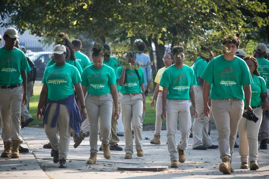 The Green Corps, the youth employment program with the Greening of Detroit, are working with the trees at the Greening of Detroit park in Detroit on Friday, August 3, 2018.