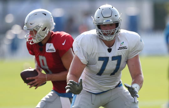 Detroit Lions offensive lineman Frank Ragnow runs through a drill with quarterback Matthew Stafford during practice Friday, Aug. 3, 2018, in Allen Park.