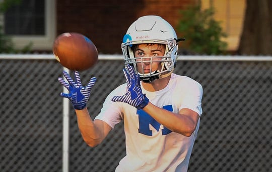 Memorial High School's Will Brackett (25) makes a reception during afternoon practice Thursday, August 2, 2018.