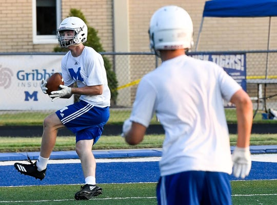 Memorial High School's Brock Combs (6) makes a catch near the end-zone during afternoon practice drills last season.