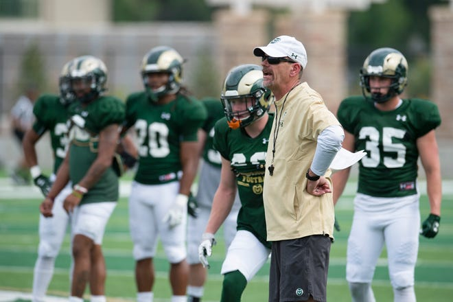 CSU football coach Mike Bobo gives instructions to the Rams during practice outside of Canvas Stadium on Thursday, August 2, 2018.