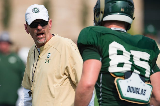 "CSU football coach Mike Bobo, who was hospitalized over the weekend for ""medical evaluation,"" gives instructions to players during an Aug. 2 practice."