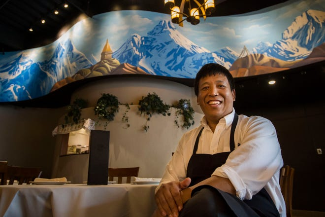 Owner and operator Dawa Sherpa poses for a portrait in the dining room his restaurant on Friday, Aug. 3, 2018, at Himalayan Bistro in Fort Collins, Colo.