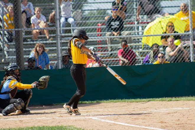 Yanni David slaps the ball in a game where the Southeast Senior softball team from Florida District 9 rallied from a 5-0 deficit to beat Hawaii 6-5 in eight innings on Thursday.