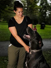 Rachel Vandevelde of Allouez and her Great Dane, Odin. He's very loving to people, but not children's toys.