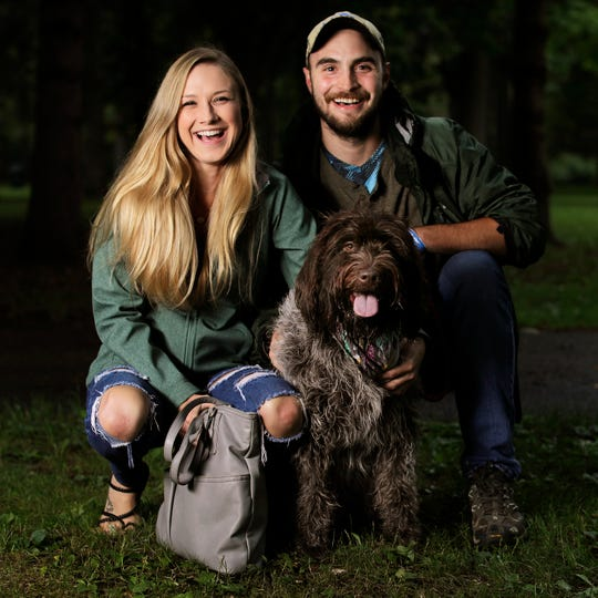 Preston Florianschitz and Brittany Kloida of Hobart with Cambria, their wirehaired pointing griffon. She's goofy, but may be too much of a follower.