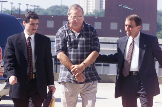 FILE PHOTO: Federal Agents escort Ronald E. Hughey into their office in Greenville. Hughey and three other upstate residents were taken into custody early Tuesday Morning, August 21, 2001, for conspiracy to commit mail fraud.