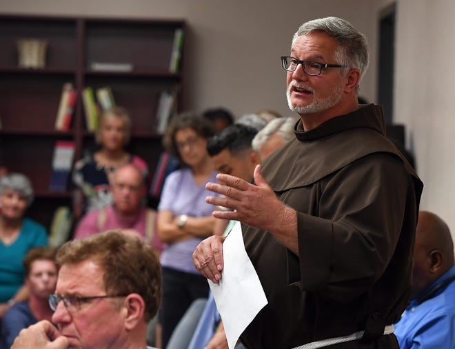St. Anthony Catholic Church pastor Patrick Tuttle speaks in opposition of a proposed townhouse project at 214 North Leach St. during a neighborhood meeting Thursday, Aug. 2, 2018, in Greenville.