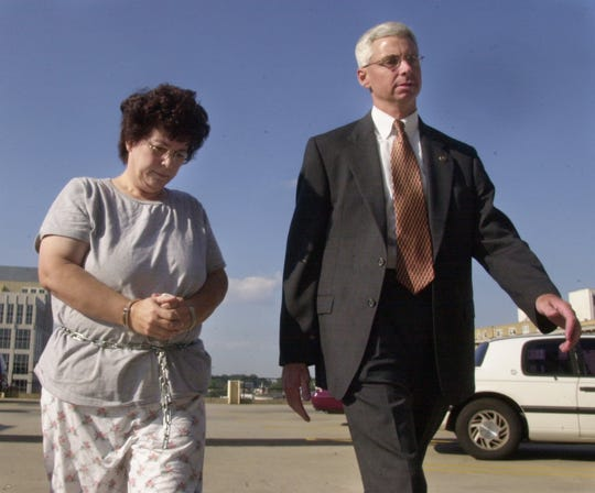 FILE PHOTO: Federal Agents escort Linda Baker into their office in Greenville. Baker and three other upstate residents were taken into custody early Tuesday Morning, August 21, 2001, for conspiracy to commit mail fraud.