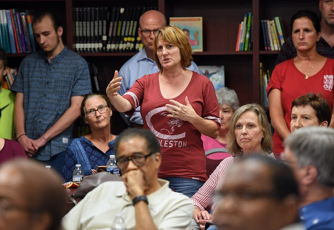 St Anthony Catholic Church member   and neighborhood resident Christen Polombo speaks in opposition of a proposed townhouse project at 214 North Leach Street in downtown Greenville during a neighborhood meeting Thursday, August 2, 2018 in Greenville.