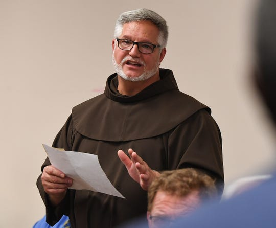 St Anthony Catholic Church pastor father Patrick Tuttle speaks in opposition of a proposed townhouse project at 214 North Leach Street in downtown Greenville during a neighborhood meeting Thursday, August 2, 2018 in Greenville.
