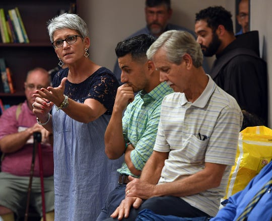 St Anthony Catholic Church member Pam Wessell speaks in opposition of a proposed townhouse project at 214 North Leach Street in downtown Greenville during a neighborhood meeting Thursday, August 2, 2018 in Greenville.
