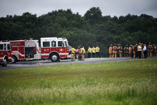 Emergency crews at the scene of a a plane crash at the Greenville Downtown Airport Friday, August 3, 2018.