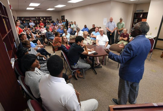 Robert Jenkins, Sr., right, speaks during a neighborhood meeting Thursday, August 2, 2018 in Greenville to discuss the proposed townhouse project on his property at 214 North Leach Street in downtown Greenville.