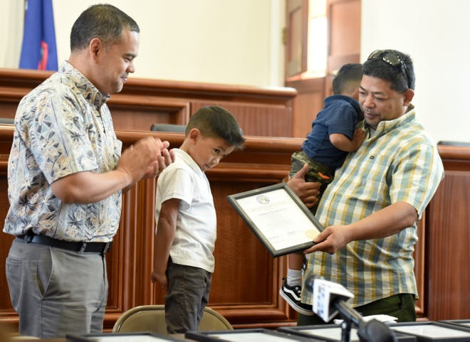 Five-year-old Jordy Evaristo was among seven people recognized with certificates in the July 22 rescue and resuscitation of his little brother Kaai Evaristo, 3, at the Guam Legislature on Friday, Aug. 3, 2018. After Sen. Dennis Rodriguez Jr. presented him the certiciate, Jordy Evaristo handed it over to father Joel Evaristo, right, who was holding Kaai Evaristo at the ceremony.