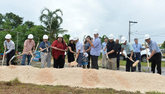 Officials including, fourth from left, Tamuning Mayor Louise C. Rivera, business owner Franco Hui, Lt. Gov. Ray Tenorio and others break ground for the new Midea building in Tamuning on Aug. 3. The building expected to be completed in eight months.