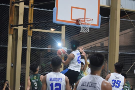The Barrigada Crusaders Black's Jesse Martin makes a strong move to the basket over a Sinajana Rocker defender during their semifinal game Aug. 1 at the Sinajana gym. Barrigada won 54-23 and will play the Maverics for the U16 title on Aug. 4.