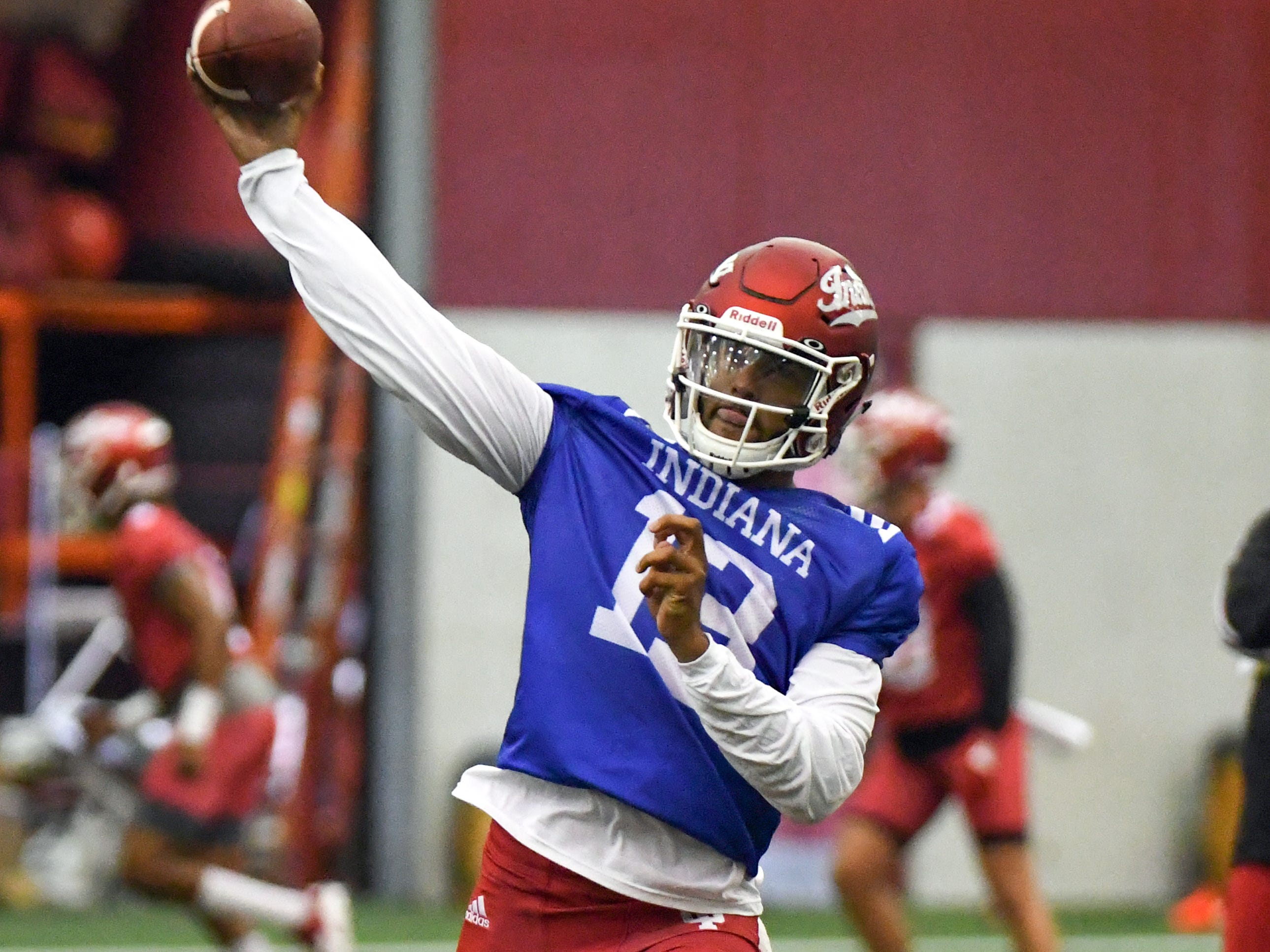 Indiana Hoosiers quarterback Brandon Dawkins (13) throws a pass during IU's practice at Mellencamp Pavilion in Bloomington, Ind., on Friday, August 3, 2018.