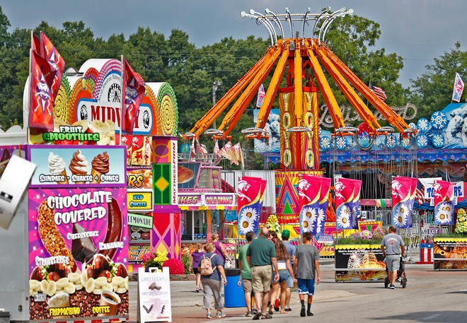 Food and rides can be found, on opening day of the Indiana State Fair, Friday, Aug. 3, 2018.