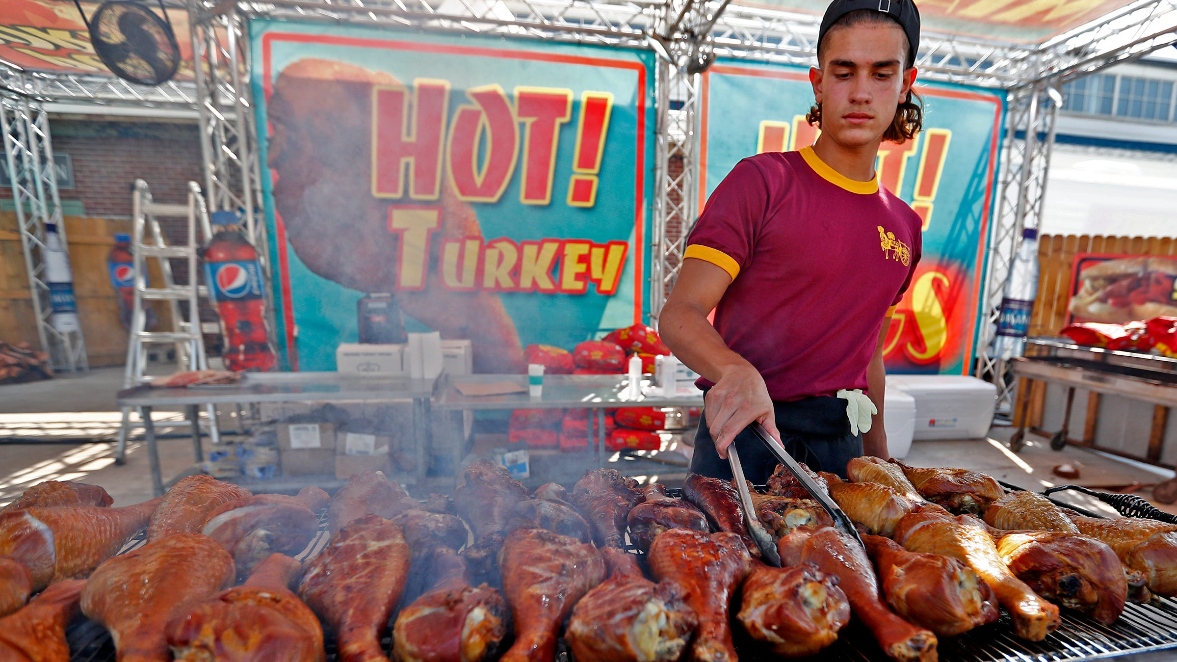 Luis Garcia cooks turkey legs on opening day of the Indiana State Fair, Friday, Aug. 3, 2018.