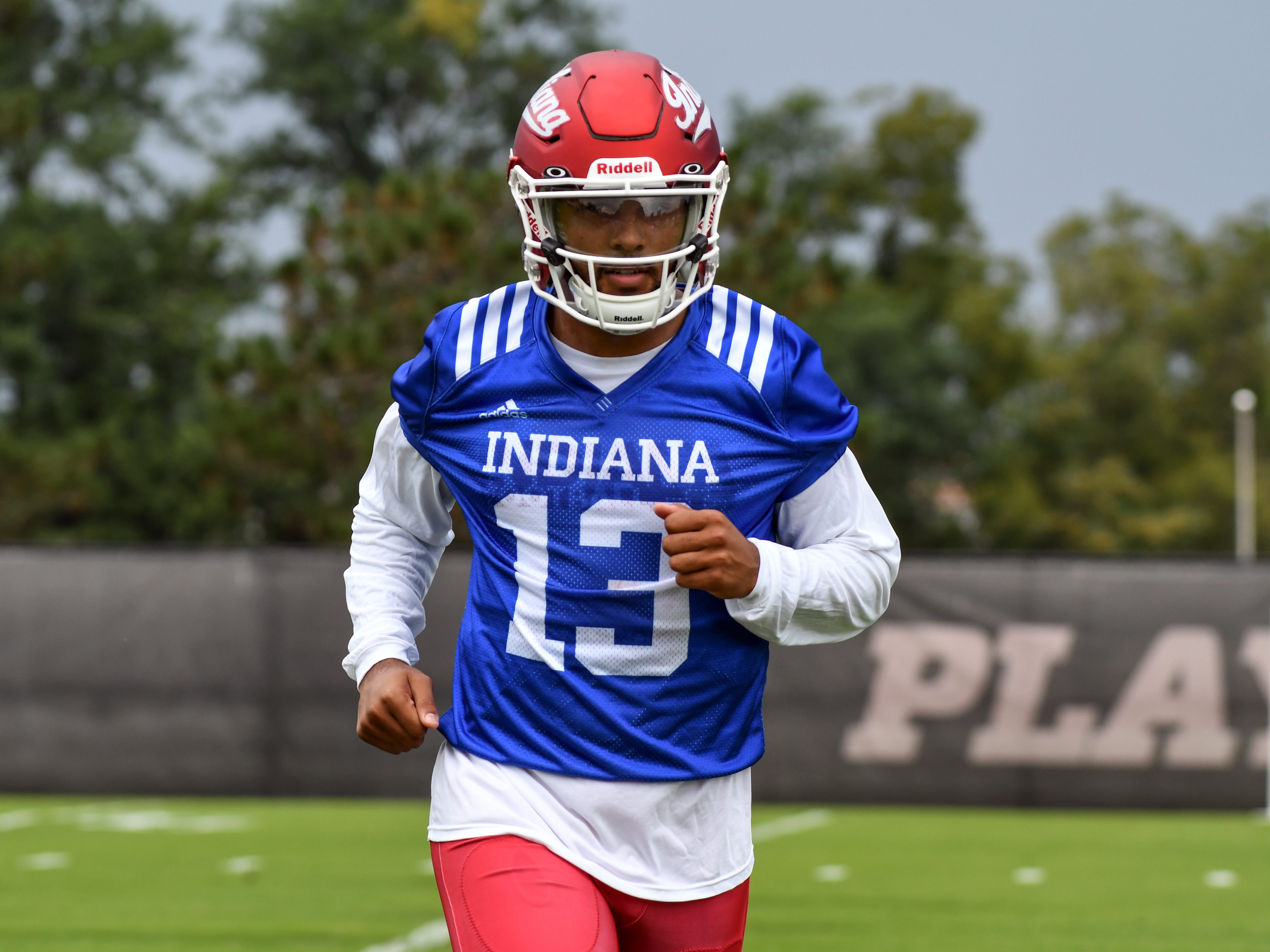 Indiana Hoosiers quarterback Brandon Dawkins (13) jogs off the field during IU's practice at Mellencamp Pavilion in Bloomington, Ind., on Friday, August 3, 2018.