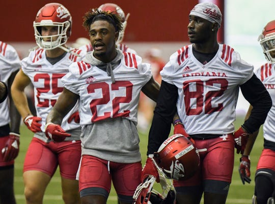 Indiana Hoosiers wide receiver's Whop Philyor (22) and Jacolby Hewitt (82) walk to a drill during IU's practice at Mellencamp Pavilion in Bloomington, Ind., on Friday, August 3, 2018.