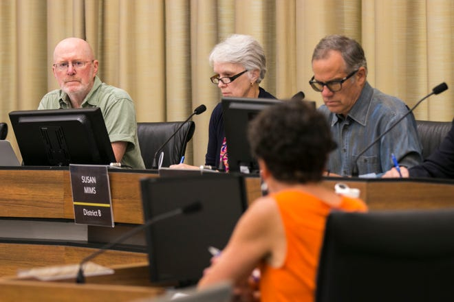 Iowa City Mayor Jim Throgmorton (far left) listens to Eleanor Dilkes during a meeting on Friday, Aug. 3, 2018, at City Hall in Iowa City, Iowa.