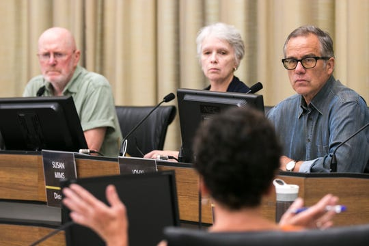 City Councilor John Thomas (far right) is seen during a meeting on Friday, Aug. 3, 2018, at City Hall in Iowa City, Iowa.