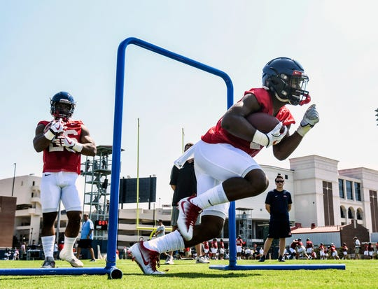 Ole Miss running back Scottie Phillips (22) runs through a drill during NCAA college football practice in Oxford, Miss., Friday, Aug. 3, 2018.  (Bruce Newman, Oxford Eagle via AP)