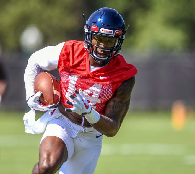 Ole Miss wide receiver D.K. Metcalf catches a pass during NCAA college football practice in Oxford, Miss., Friday, Aug. 3, 2018.  (Bruce Newman, Oxford Eagle via AP)
