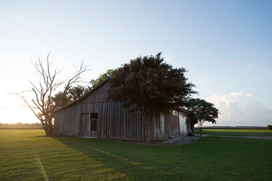 The sun sets on the barn in Drew, Mississippi where 14-year-old Emmett TIll was beaten and murdered by Roy Bryant, and his half-brother, J. W. Milam, in August of 1955. The men had forced their way into Till's family home, grabbed Till out of bed at gunpoint, and took him away. Three days later, Till's beaten, swollen, and decomposing