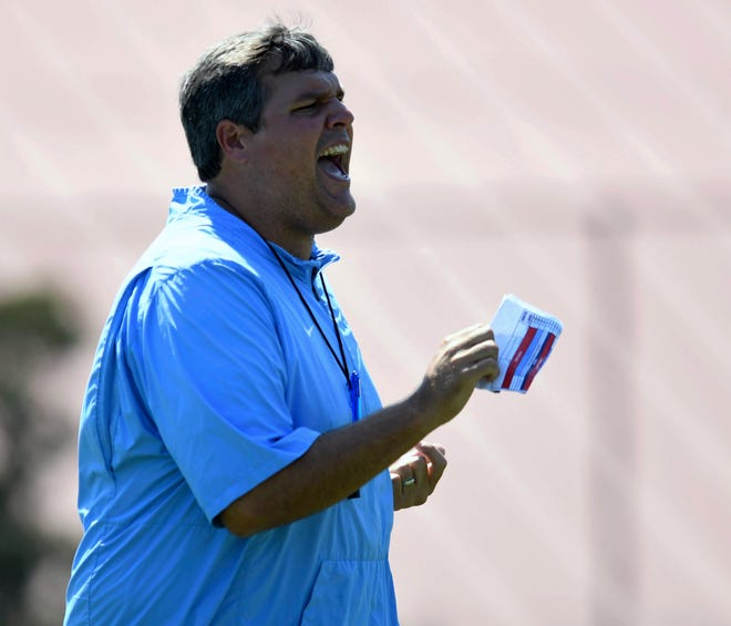 Ole Miss head coach Matt Luke gives instructions during NCAA college football practice in Oxford, Miss., Friday, Aug. 3, 2018.  (Bruce Newman, Oxford Eagle via AP)