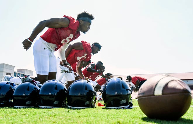 Ole Miss wide receiver DeMarkus Lodge (5) and other members of the receiving corps run through a drill during NCAA college football practice in Oxford, Miss., Friday, Aug. 3, 2018.  (Bruce Newman, Oxford Eagle via AP)