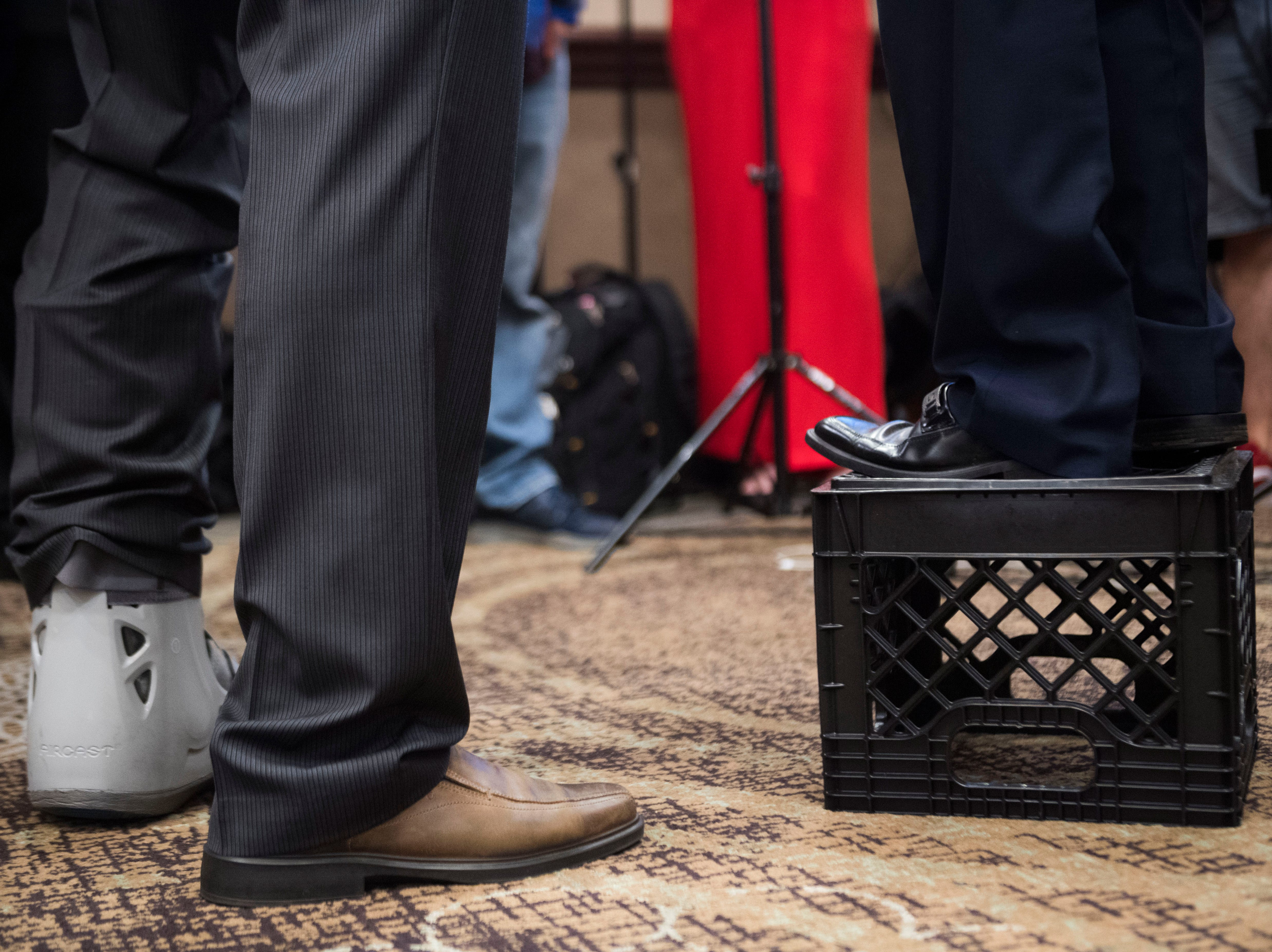 A member of the media stands on a milk crate to interview Glenn Jacobs at the Crowne Plaza on election day in Knox County Thursday, Aug. 2, 2018.
