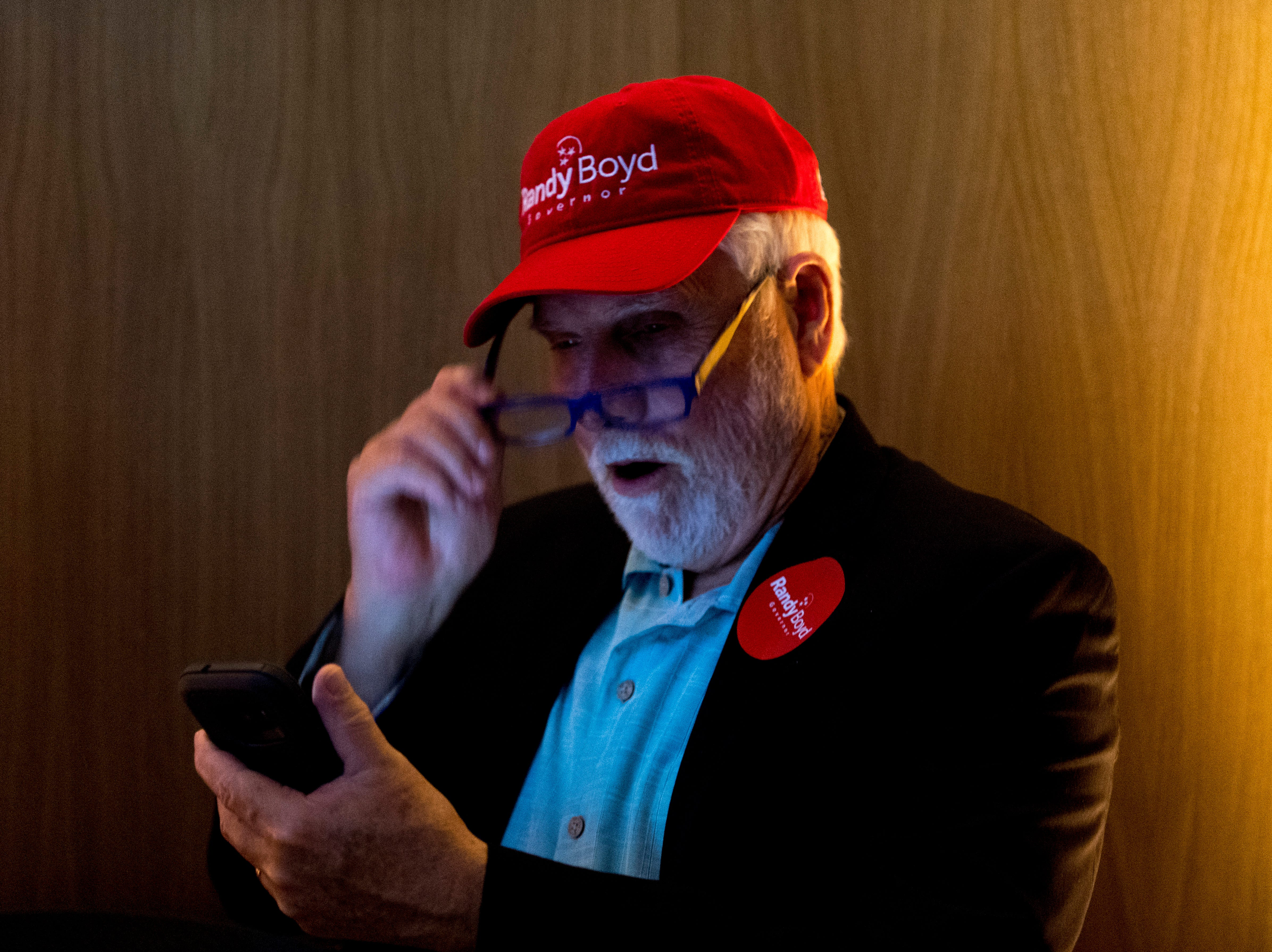 Danny Hansard, of Knoxville, looks at the poll numbers on his phone at the Randy Boyd for Governor watch party at Jackson Terminal in Knoxville, Tennessee on Thursday, August 2, 2018.