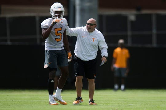 Joe Osovet speaks to player Alontae Taylor during the first Vols football practice of the season Friday, Aug. 3, 2018.