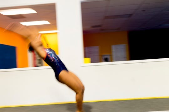 Ayanna Albright does a vault during practice at Premiere Athletics in Knoxville, Tennessee on Friday, July 27, 2018. Tia Taylor, Savanna Cecil and Ayanna Albright will represent Team USA at WAGS in St. Petersburg Russia in November.