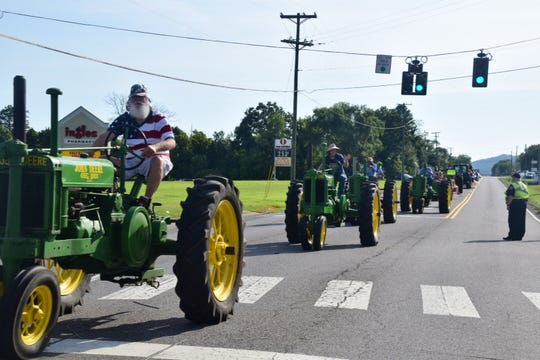 Beautifully maintained tractors loudly chug their way down Oak Ridge Highway during the parade opening the 2018 Karns Community Fair on Saturday, July 28. The tractors always garner loud cheers from the crowd. Some say it wouldn't be a Karns parade without them.
