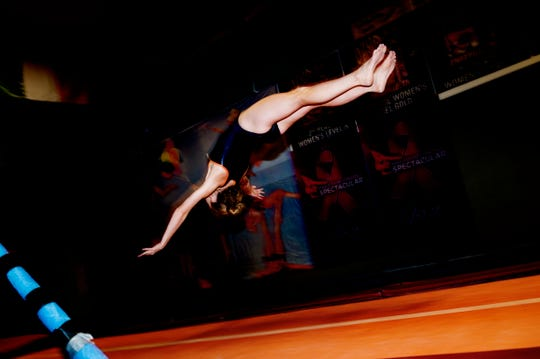 Savanna Cecil vaults during practice at Premiere Athletics in Knoxville, Tennessee on Friday, July 27, 2018. Tia Taylor, Savanna and Ayanna Albright will represent Team USA in St. Petersburg, Russia, in November.
