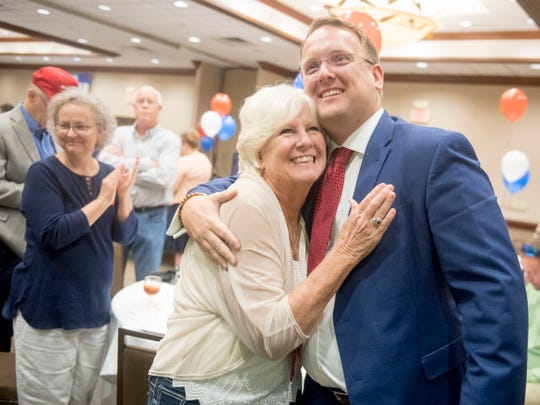 Pat Biggs congratulates her son Justin Biggs at the Knox County GOP watch party on Thursday, August 2, 2018.