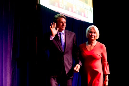 Randy Boyd and his wife, Jenny, take the stage during his watch party at Jackson Terminal in Knoxville, Tennessee on Thursday, August 2, 2018.