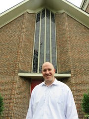The Rev. Troy Forrester, the senior pastor at First United Methodist Church, stands inside the church on Aug. 1, 2018
