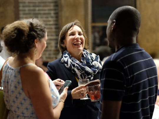 Renee Hoyos, Democratic candidate for Tennessee Second Congressional District, mingles with supporters during Knoxville's Democratic watch party at the Foundry in Knoxville on Aug. 2.
