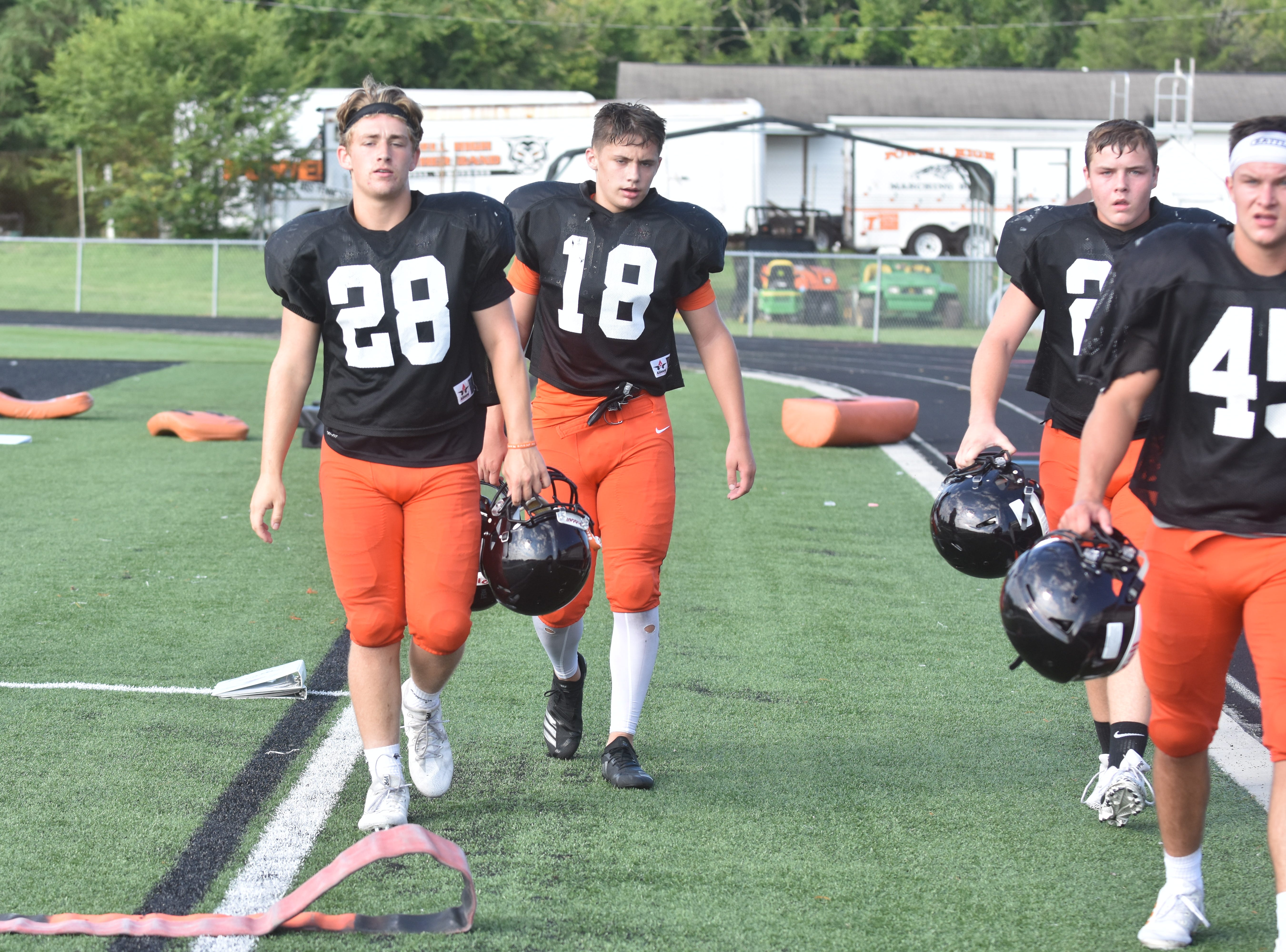 Powell football players take a break from running drills during a recent practice.