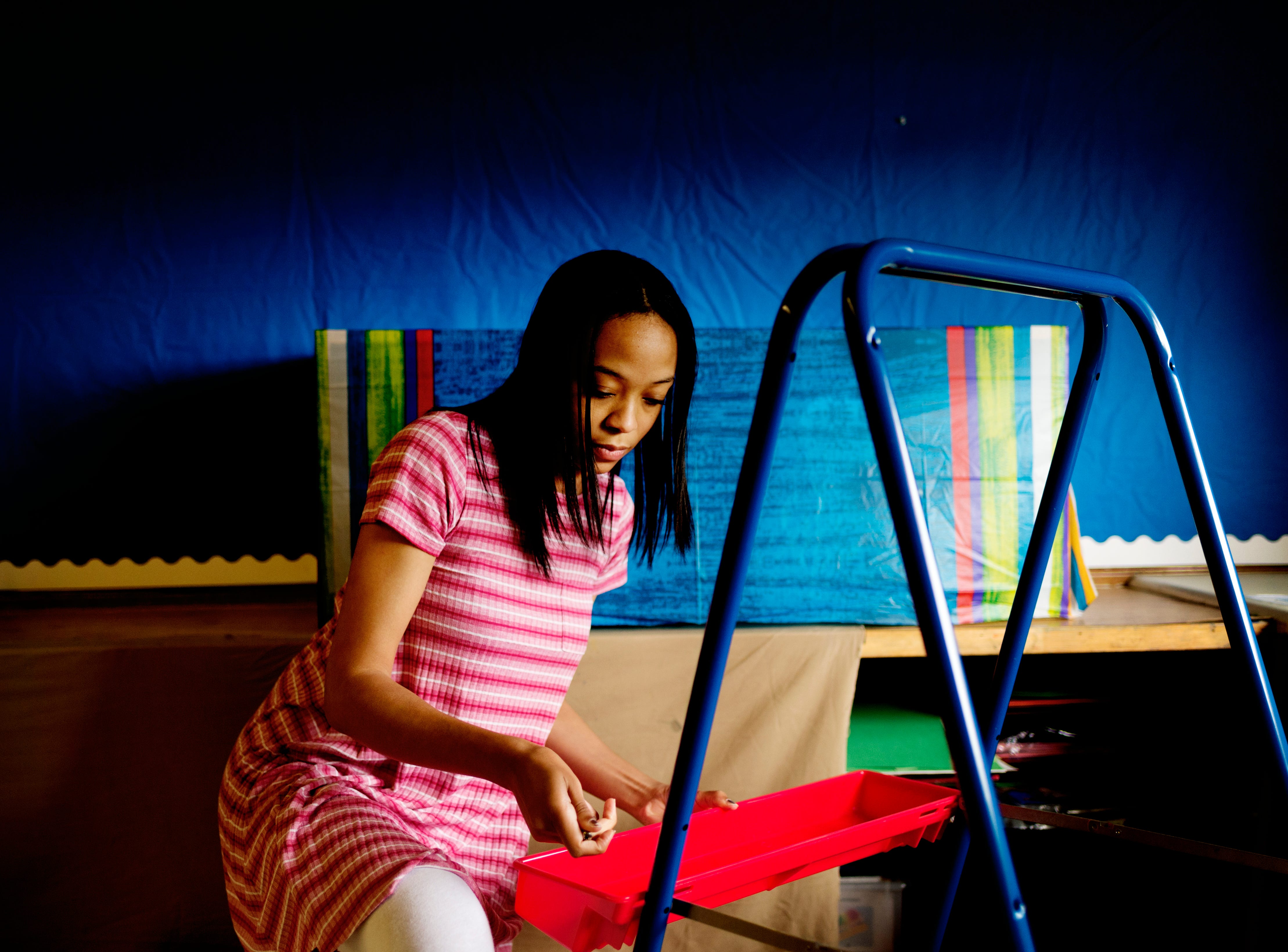 Kindergarten teacher Porscha Settlemyer assembles a painting easel in her room at Sam E. Hill Primary School in the Lonsdale community in Knoxville, Tennessee on Friday, August 3, 2018. The school has newly transitioned from a preschool into a primary school.