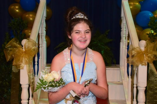 "Kiley Newcomb, 14, a special needs contestant, garnered the loudest cheers when answering ""What makes you beautiful?"" She answered ""I'm beautiful because God made me."" 2018 Fairest of the Fair Competition at Karns High School Saturday, July 28."